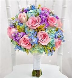 Spring Bridal Bouquet We like this one but with white roses.