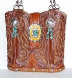 This StageCoach Bag is fashioned from a pair of vintage Tony Lama cowboy boots.  Handcrafted, one of a kind, leather purse.  Each purse is a numbered and named piece of fashion wear.  This one is named Toni.  www.stagecoachbagsandcollectibles.com Fashion Wear, You Bag, Leather Purses, Cowboy Boots, Purses And Bags, Bucket, Pairs, Horses, Handbags