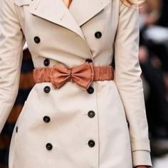 Belted beige trench coat