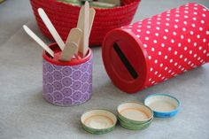 Toddler activity: cut holes in the lid of a recycled container for practice with popsicle sticks