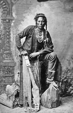 Curly (c1856-1923). Crow Indian (Montana). In several skirmishes with the Sioux in his youth. Indian scout for the U.S. Army in 1876 at about 20. At the Battle of Little Big Horn in June 1876. - Photo by David F. Barry, c1885. - (B/W copy)