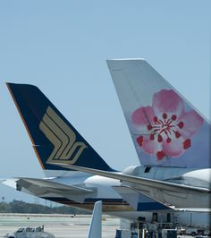 China Airlines and Singapore Airlines tails