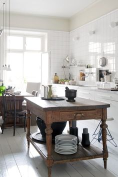 modern country kitchen with mobile furniture for the island bench.