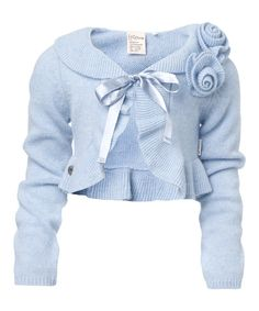 As lovely as a layer can be, this bolero is constructed out of a warm wool blend that wears wonderfully over every outfit. With prim ruffles and a set of rosettes, it's the fashionable and functional solution to every girl's closet.50% wool / 40% angora / 10% polyamideDry cleanMade in the Netherlands