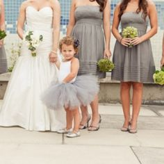 One super cute little bridesmaid with lots of grey inspiration via Erin Hearts Court. #weddinggawker