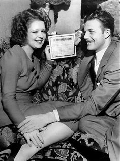 Clara Bow with husband Rex Bell holding their marriage certificate, 1931