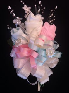 """Baby Shower corsage for the Mommy-to-be... the """"roses"""" are baby socks!"""