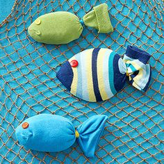 Swimming sock fish - Option:  add magnets inside sock. Have kids take turns casting magnetic poles into a hula-hoop pond to catch fish.