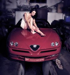Perhaps she is dyeing her fingernails Alfa Rosso Red...