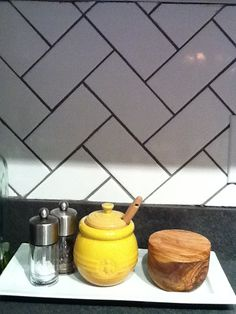 White herringbone subway tile, but we would use a slightly lighter grout. Still dark enough to be distinctive, but not black.