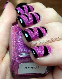 Use two coats of Elixir Lacquers With a K, covered with one coat of SV, since using tape. Cut even strips and stripe them over nails, then apply one coat of Kiss Black, and remove the tape immediately. Do this on each nail, and finish it all off with a coat of Cult Nails Wicked Fast.