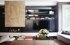 Welcome to darren palmer interiors Black cabinetry to make TV blend in