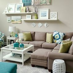 white and neutral living room with lots of pops of color!