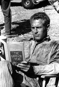 Paul Newman-reading on the set of Cool Hand Luke. (my kind of man :)