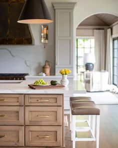 This view into the kitchen and sunroom of our #europeaninspiredremodel is a favorite. Between the range hood, arched doorway, and the… #KitchenInteriorDesignIdeas