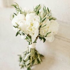 Such a beautiful  simple bouquet  #Repost @vintageweddingwonderland ・・・ Peonies & olive branches..Love it! Happy #Monday!! Have a good week! X Bouquet by: Blandine Viry & Photography by: Xavier Navarro #natural #bride #different #bouquet #Provence #herbal  #bouquet  #weddinginspo #huntthatdress