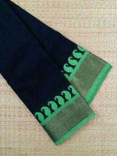 Black saree with leafy green paisley border
