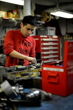 Aviation Ordnanceman Airman Derek Willett, from Houston, disassembles a BRU-32 bomb ejector rack in the ordnance shop aboard the aircraft carrier USS John C. Stennis (CVN 74). John C. Stennis is deployed to the U.S. 5th Fleet area of responsibility conducting maritime security operations, theater security cooperation efforts and support missions for Operation Enduring Freedom.