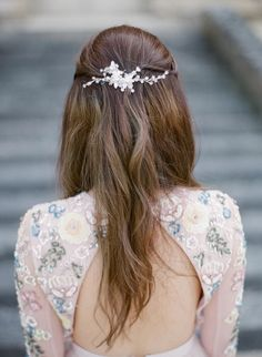 Elegant embellished half up half down hairstyle: http://www.stylemepretty.com/little-black-book-blog/2016/12/27/fashion-forward-engagement-session-in-a-french-chateau/ Photography: Greg Finck - http://www.gregfinck.com/