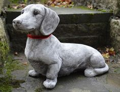 DACHSHUND - very rare, lifelike garden ornament now back in stock with his new, festive look. www.onefold.co.uk