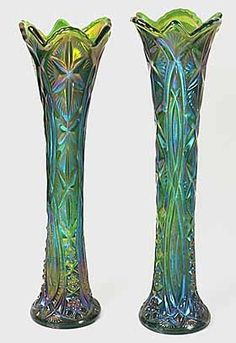 Millersburg carnival swung vases in Ohio Star pattern.  Swung vases are taller versions of their normal counterparts.   http://www.morninggloryantiquescollect.com/