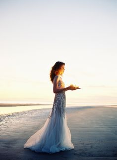 walk on the beach barefoot in a pretty dress. Something so feminine and lovely about your feet in the water while dressed up