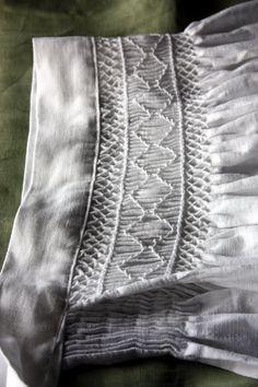 Medieval Silkwork: Smocked apron finished