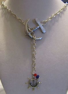 Nautical Sailor Inspired Anchor and Wheel Necklace Lariat Summer Ocean Beach. $15.99, via Etsy.