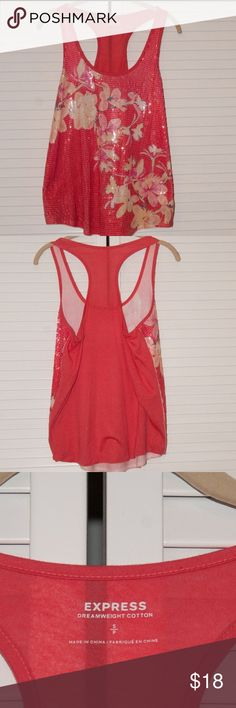 Express Size Small Sequin Tank Beautiful sequin tank from Express! Dreamweight cotton fabric. I didn't find any missing sequins when I was inspecting it, so I'd say it's in great preowned condition!  Comes from a cat-friendly, smoke-free home. My items are kept in a room the cats can't access, but since they are in the house I wanted to mention in case of allergies. I ship daily Monday-Friday except holidays.  As always, reasonable offers are welcome! Express Tops Tank Tops