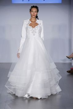 Style * HP6509 * DOLLY  Bridal Gowns, Wedding Dresses  Spring 2015 Collection  by Hayley Paige  Shown Ivory hand cut faux leatheqr ball bridal gown, sculpted bodice with scalloped eyelet sweetheart neckline, tiered tulle skirt with horsehair trim, shown with matching jacket.