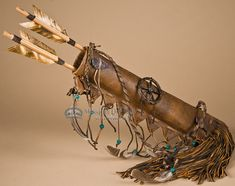 This is a beautiful small American Indian deer skin quiver set for rustic southwest, western and Native American decor. Made by the Navajo Indians, this genuine deer skin quiver features decorative ar