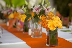 Sorta cool and easy, different bright flowers on a silid runner for center pieces