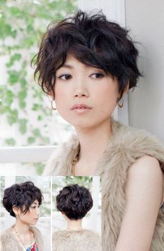 Cute short curly haircut. Okay, it's more wavy than curly