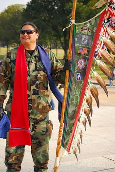 Native American soldier with his eagle feather staff