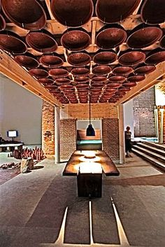 Arsenale: Anupama Kundoo – Wall House – One to One. Kundoo, an Indian architect now based in Australia, has built an ambitious, 1:1 facsimile of the Wall House, a building she designed in Auroville, India in 2000.