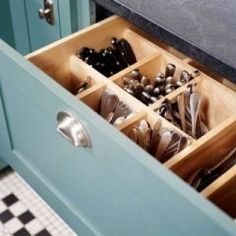 This is the best silverware drawer idea I've ever seen. But I would put cute labels because you can't really tell what they are from upside down.