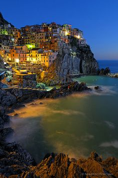 "Manarola, Cinque Terre, Italy - The Cinque Terre, are five small villages on the ""Costa Ligure of Levante"". ... villages from north to south are: Monterosso al Mare, Vernazza, Corniglia, Manarola, and Riomaggiore. .... ""Hidden Gems on the Italian Riviera"", Los Angeles Times."
