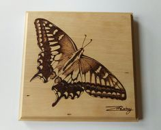 Signed Swallowtail hand pyrography picture.