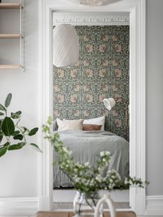 William morris pimpernel wallpaper in the bedroom of a swedish home