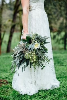 Love this greenery bouquet kissed by garden roses.