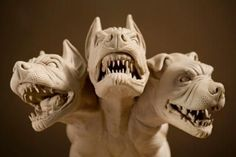 """Cerberus i n Greek and Roman mythology, is a multi-headed (usually three-headed) dog, or """"hellhound"""" which guards the entrance of Hades, to prevent those who entered from ever escaping."""