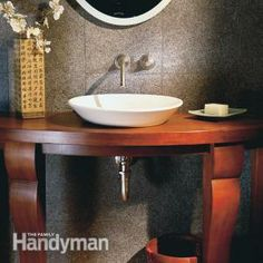 Elegant Small Bathroom Beautify a small bathroom with a wall-mount faucet, vessel sink and console table