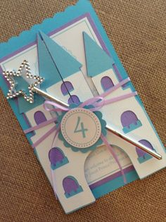 Deluxe Handmade Frozen Castle Invitations including ribbon and wand. You will receive: - 12 Party Invitations - 5x7 - 12 White