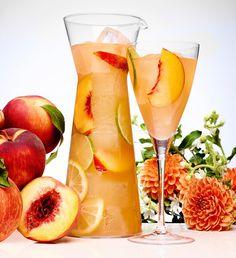 Peach Sangria (10 oz peach-flavored vodka 5 oz Hennessy 5 oz fresh lime juice 5 oz fresh lemon juice 1 oz simple syrup 40 dashes bitters 20 oz club soda)