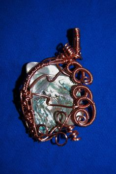 wire wrapped and woven abalone and copper pendant