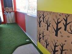 A miniature golf course in a kiddies' playroom inspired by Taubmans - amazing!