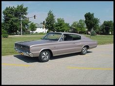 1966 Dodge Charger.  Had the third one in New England, just like this with red interior.  383 4bbl dual exhaust, torqueflite, limited slip, fast and fun.  Miss it.