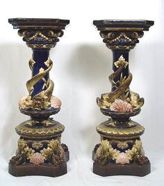 FABULOUS PR MINTON MAJOLICA PEDESTAL STANDS: Attributed to. With dolphins encircling the pedestals with shells, frogs, and incredible paw feet with plinth below.