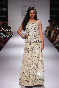 Away from the shine of mirror work, some designers touted the exact opposite of blinged out lehengas – the print skirt. Bold, subdued, floral– take your . Ethnic Fashion, Asian Fashion, India Fashion, London Fashion, Women's Fashion, Indian Dresses, Indian Outfits, Kaftan, Eastern Dresses