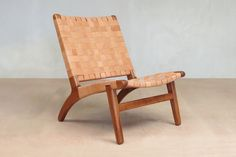 Our popular modern armless lounge chair in Barley leather, hand-wrapped around a sustainably harvested hardwood frame in a classic Danish lounge chair design.